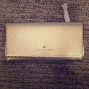Kate spade gold wallet. Never used!!